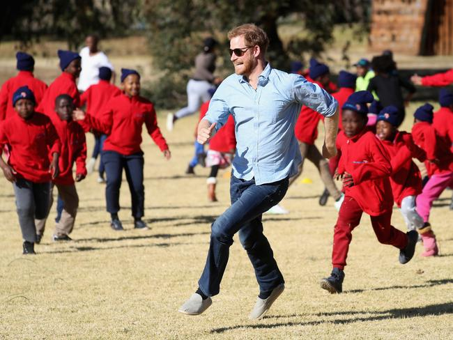 Prince Harry, seen here in June 2018 running with children during Winter Camp at Sentebale's Mamohato Children's Centre, is now much more active. Picture: Chris Jackson/Getty Images for Sentebale