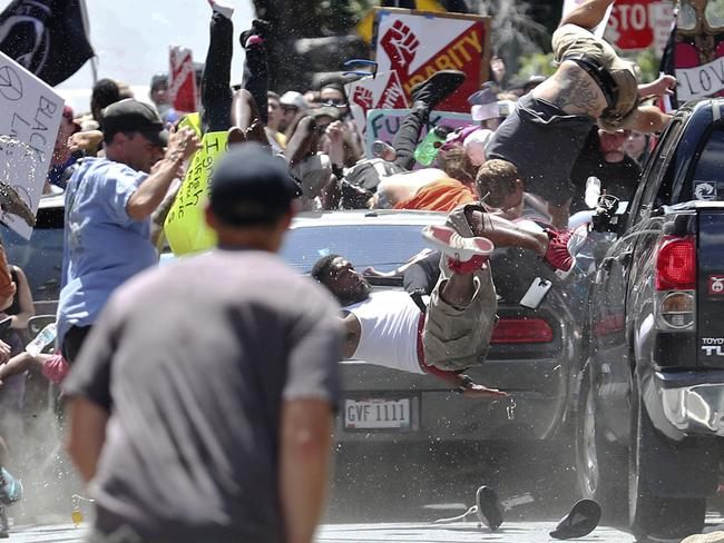 The moment the car struck the crowd. Picture: Ryan M. Kelly/The Daily Progress via AP