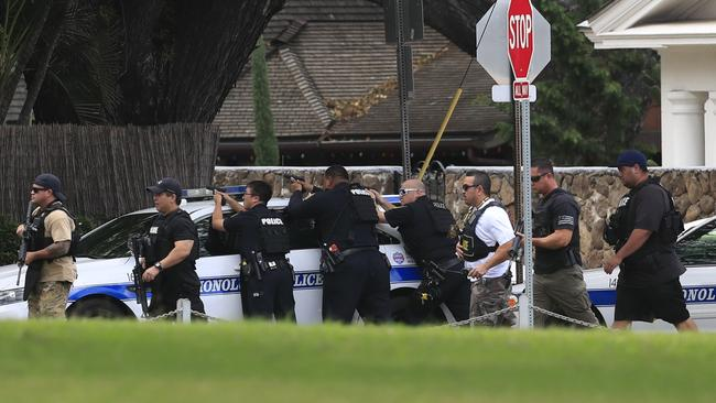 Honolulu police take up defensive positions with their weapons after a shooting and domestic incident at a residence on Hibiscus Road near Diamond Head on Sunday, Jan. 19, 2020, in Honolulu. Picture: Jamm Aquino/Honolulu Star-Advertiser via AP