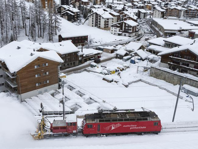 A snow blower on a train clears snow from the rail track in Zermatt, which could only be reached by air for two days. Picture: AP