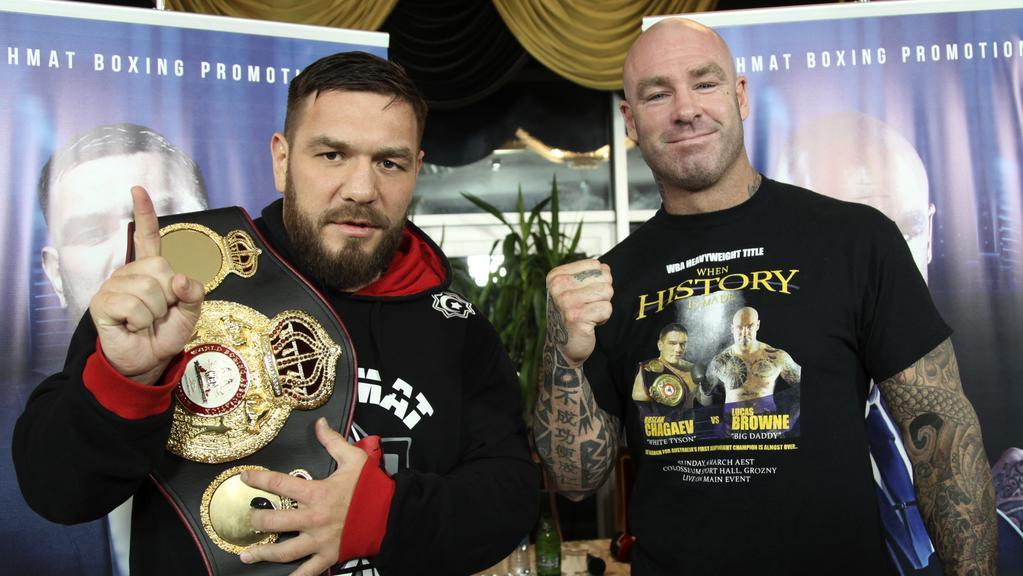 Australia's Lucas Browne, right, and Uzbekistan's Ruslan Chagaev, holding  his WBA heavyweight title