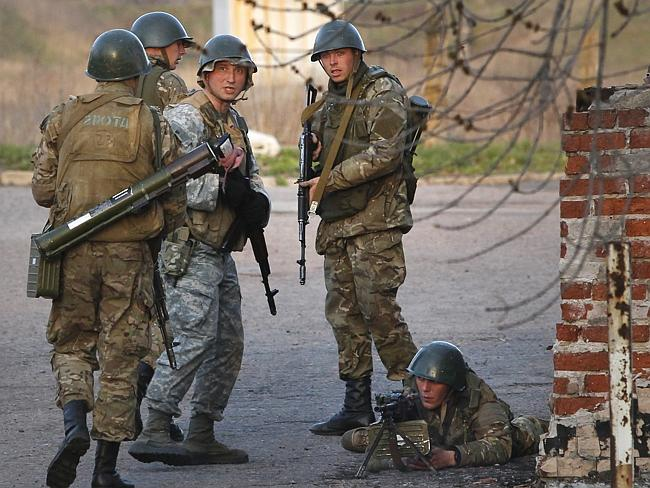 Reinforcements .... Ukrainian army troops set up a position at an airport in Kramatorsk, eastern Ukraine. Picture: Sergei Grits