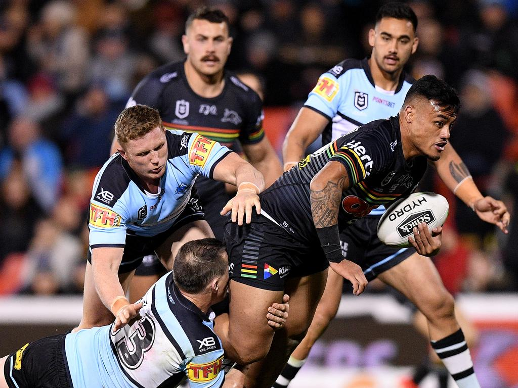 Spencer Leniu of the Panthers is tackled by Paul Gallen of the Sharks (left) during the Round 21 NRL match between the Penrith Panthers and the Cronulla Sharks at Panthers Stadium in Sydney, Friday, August 9, 2019. (AAP Image/Dan Himbrechts) NO ARCHIVING, EDITORIAL USE ONLY