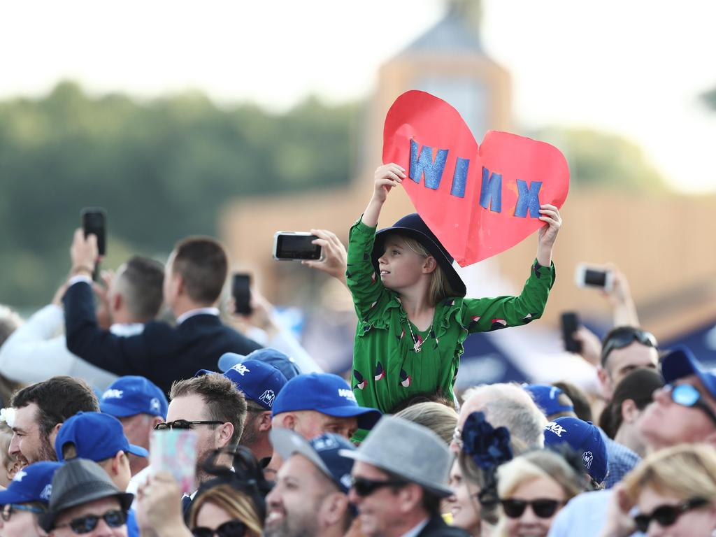 Winx fans show their support at Royal Randwick Racecourse.