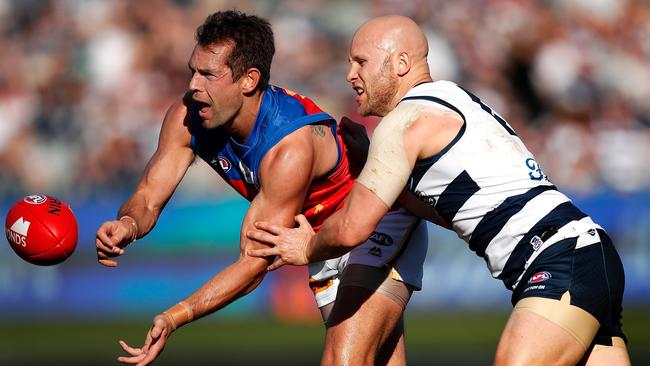 Luke Hodge and Gary Ablett have been battling it out for decades. Picture: Adam Trafford