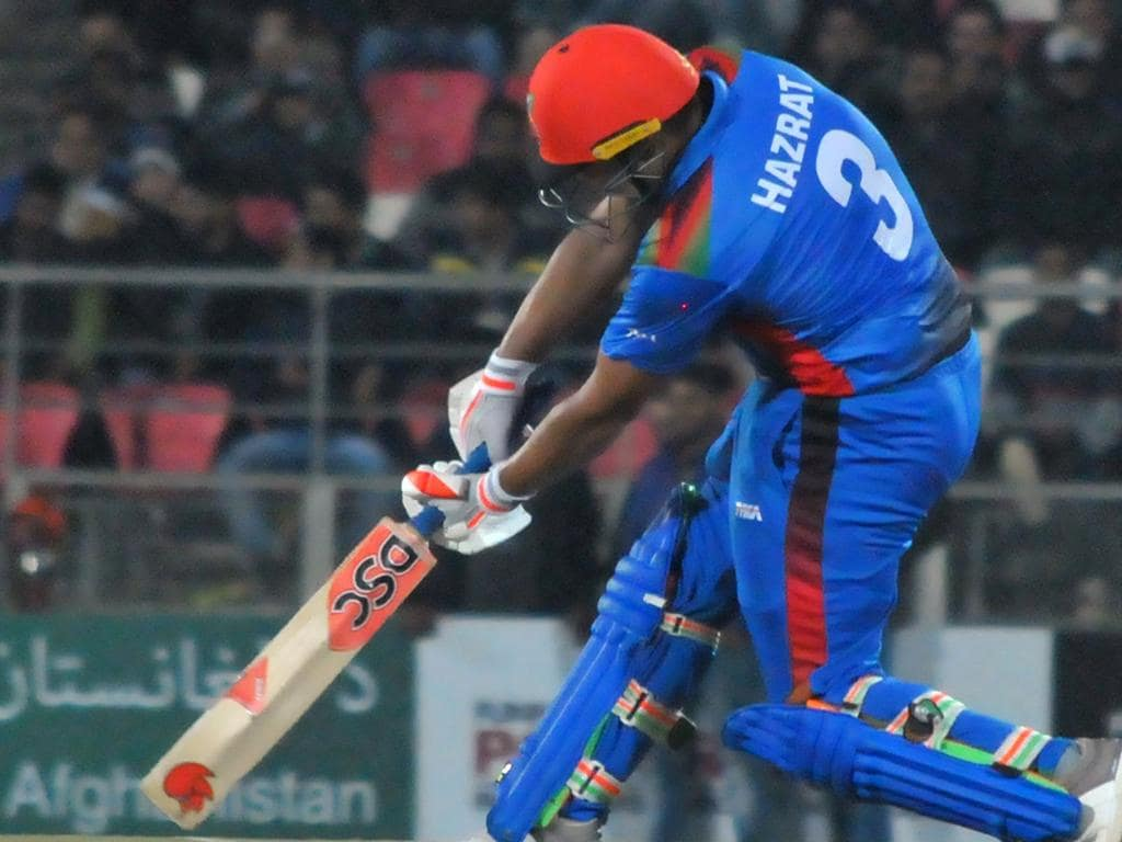 Afghan cricketer Hazratullah Zazai hits a shot during Afghanistan's International Twenty20 (T20) cricket match against Ireland in the northern Indian city of Dehradun on February 23, 2019. - Hazratullah Zazai smashed the ball to every corner of the ground, and even out of the stadium, as Afghanistan racked up a world record T20 score of 278-3 in a crushing demolition of Ireland on February 23. (Photo by STR / AFP)