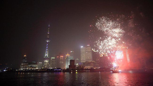 The Oriental Pearl Tower is illuminated with blue color and fireworksto mark Oreo's 100th anniversary in Shanghai. Picture: AP