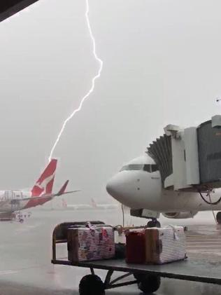 Thunderstorms roll in over Sydney Airport. Picture: Brendan Grainger/Twitter