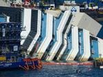 The water line that marks the former level of the stricken Costa Concordia is seen as the parbuckling project to raise the ship continues on September 16, 2013 in Isola del Giglio, Italy. Work begins today to right the stricken Costa Concordia vessel, which sank on January 12, 2012. If the operation is successful, it will then be towed away and scrapped. The procedure, known as parbuckling, has never been carried out on a vessel as large as Costa Concordia before. (Photo by Marco Secchi/Getty Images)