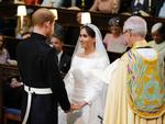 Prince Harry and Meghan Markle during their wedding service, conducted by the Archbishop of Canterbury Justin Welby in St George's Chapel at Windsor Castle on May 19, 2018 in Windsor, England. Credit: Dominic Lipinski - WPA Pool/Getty Images