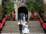 Britain's Princess Eugenie of York (R) and her husband Jack Brooksbank walk down the West Steps of St George's Chapel, Windsor Castle, in Windsor, on October 12, 2018 follwed by their bridesmades and pageboys after their wedding ceremony. (Photo by TOBY MELVILLE / POOL / AFP)