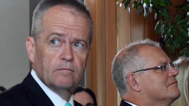 Leader of the Opposition Bill Shorten and Prime Minister Scott Morrison at an ovarian cancer event at Parliament House. Picture: AAP Image/Mick Tsikas