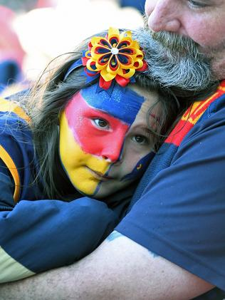 Hannah Murphy, 8, is comforted with a much-needed hug. Picture: Tom Huntley