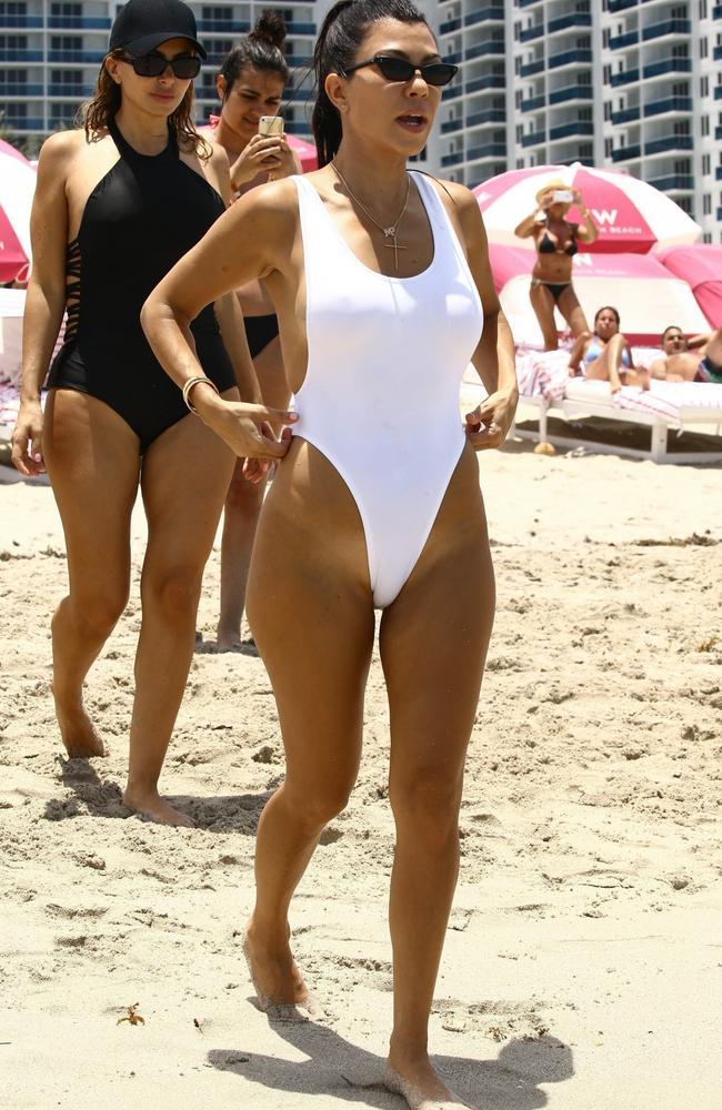 d20410ad2ca35 Kourtney Kardashian flaunts body in slinky high-cut swimsuit on ...