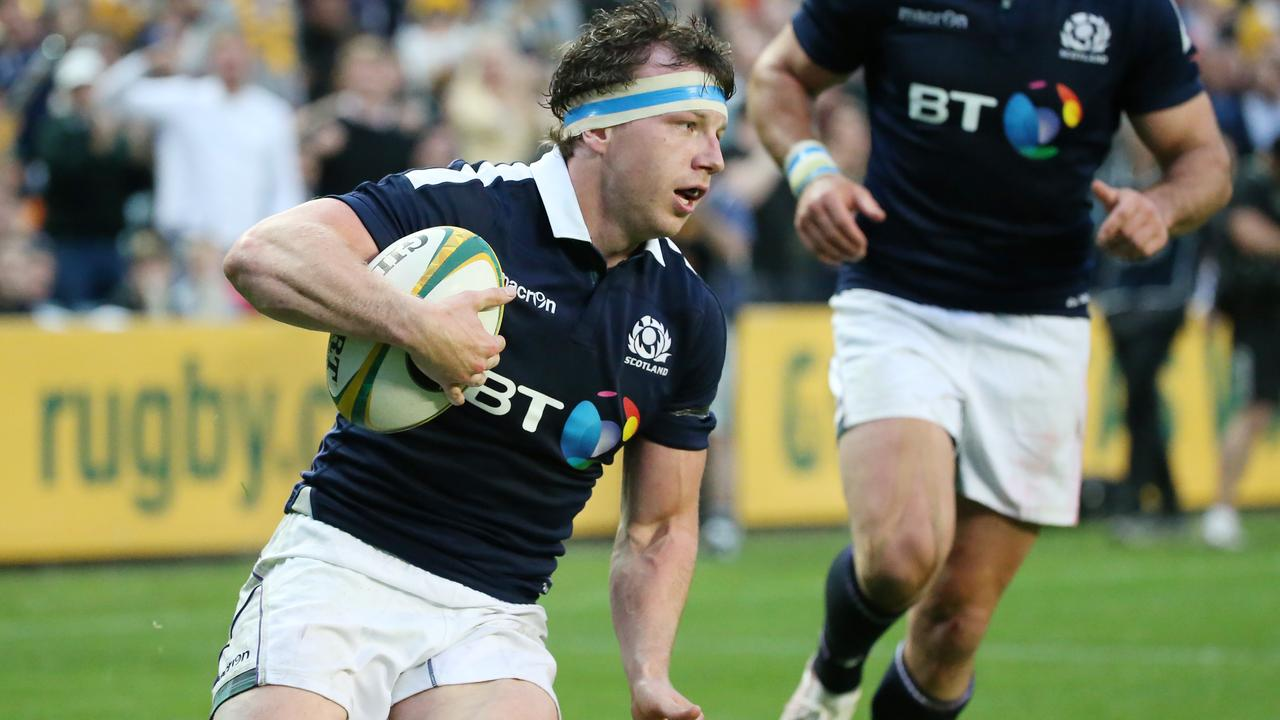 Hamish Watson of Scotland runs to score a try at Allianz Stadium in Sydney.