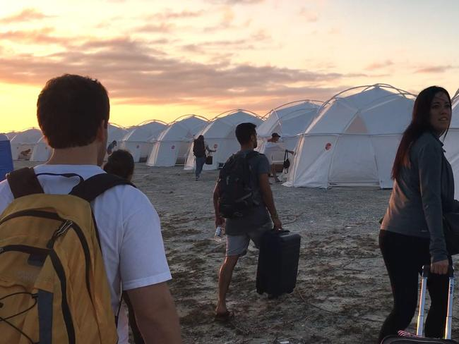Fyre Festival attendees arrive at their tents on the Bahamian island of Great Exuma. Picture: Netflix