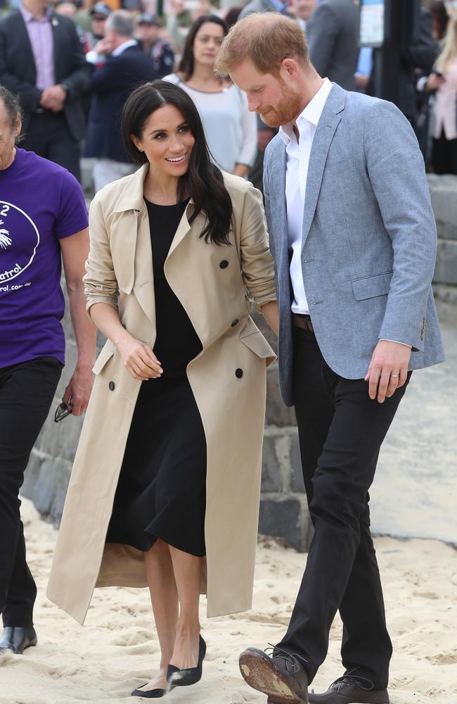 Not standard beach attire! The Duchess of Sussex changed outfits from Dion Lee to this Club Monaco frock. Prince Harry removed his tie and changed into a relaxed blazer. Picture: Alex Coppel