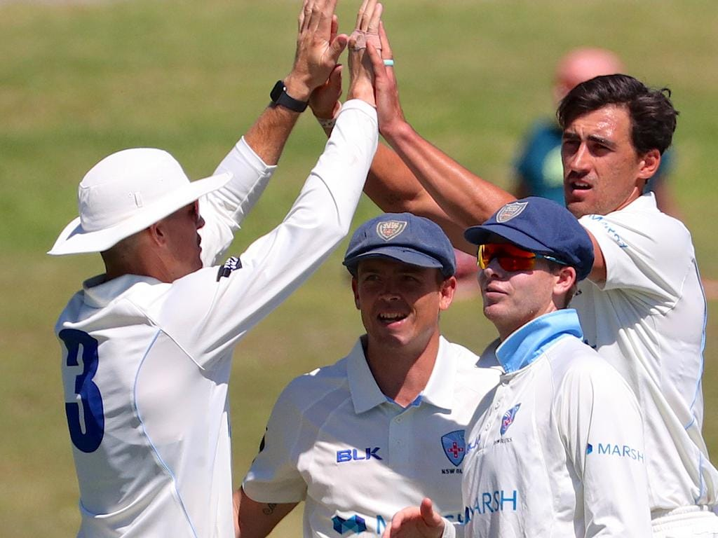 NSW player Mitchell Starc (right) celebrates with team mates after dismissing TasmaniaÕs captain Matthew Wade during day 1 of the Marsh Sheffield Shield match between New South Wales and Tasmania at Drummoyne Oval in Sydney, Friday, October 18, 2019.  (AAP Image/David Gray) NO ARCHIVING, EDITORIAL USE ONLY