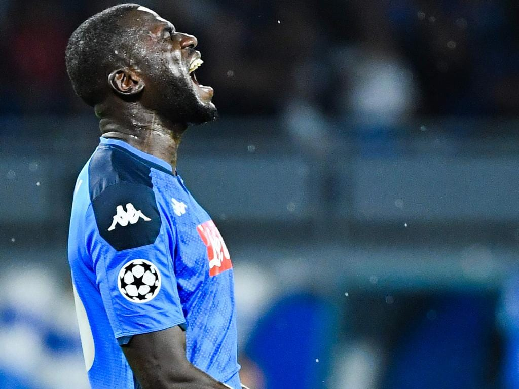 Napoli's Senegalese defender Kalidou Koulibaly reacts after missing a goal opportunity during the UEFA Champions League Group E football match Napoli vs Salzburg on November 5, 2019 at the San Paolo stadium in Naples. (Photo by Alberto PIZZOLI / AFP)