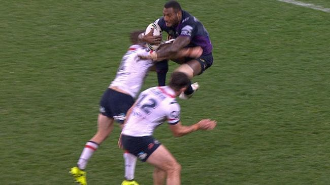 Suliasi Vunivalu takes a running leap at the defence.