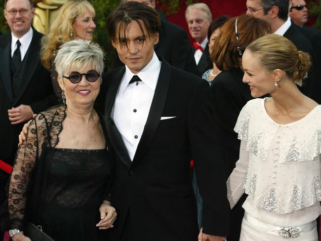 Johnny Depp with his late mother, Betty Sue, and former love Vanessa Paradis, with whom he shares two teenage children. Picture: Frank Micelotta/Getty Images