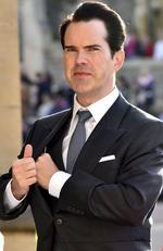 Jimmy Carr arrives for the wedding of Princess Eugenie of York and Jack Brooksbank at St George's Chapel, Windsor Castle, near London, England, Friday Oct. 12, 2018. (Matt Crossick/Pool via AP)