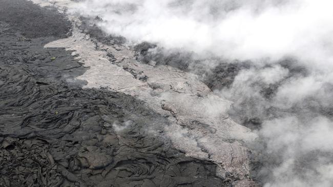 A small lava flow (lighter in colour) and spatter erupting from a section of the crack on the west flank of the Puu Oo vent of Kilauea volcano, on May 1. Picture: US Geological Survey via AP
