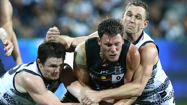 Patrick Dangerfield and Joel Selwood tackle Brad Ebert. Picture: Wayne Ludbey