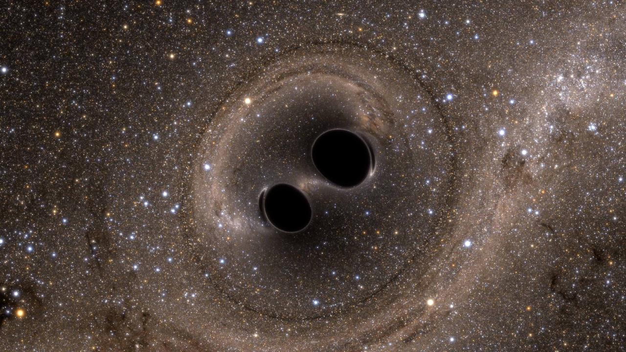 A drawing of what the colliding black holes could have looked like. Picture: AAP/ANU