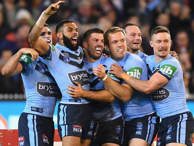 James Tedesco celebrates with teammates. Picture: Getty