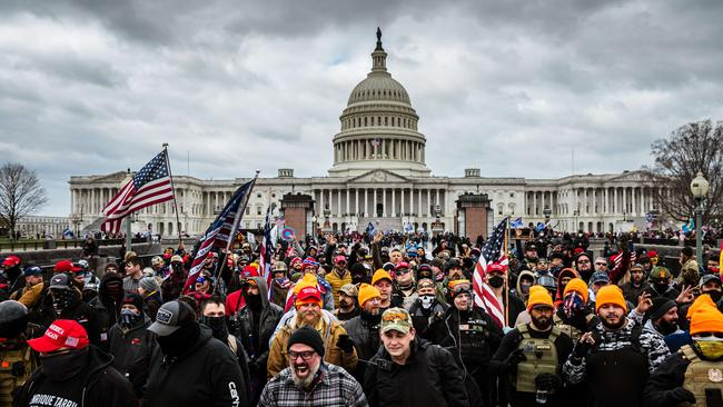 Pro-Trump protesters gather in front of the U.S. Capitol Building on January 6 before a mob stormed the Capitol, breaking windows and clashing with police officers. Picture: Jon Cherry/Getty Images/AFP.