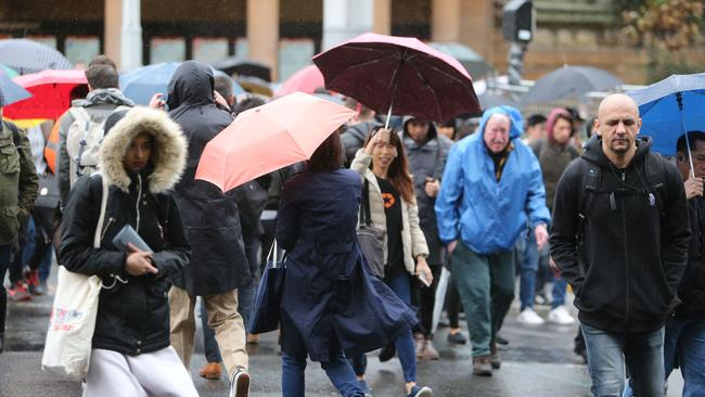 Pictured are Sydney commuters battling the wet weather in Surry Hills. Picture: Tim Hunter.