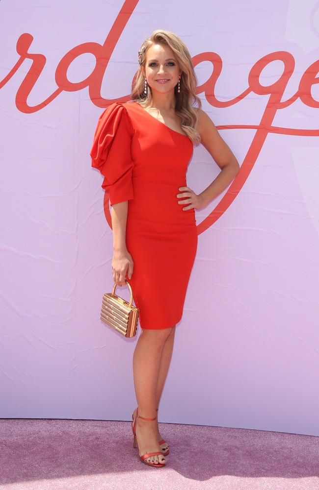 Carrie Bickmore has turned heads at Flemington in this figure-hugging red dress. Picture: MediaMode