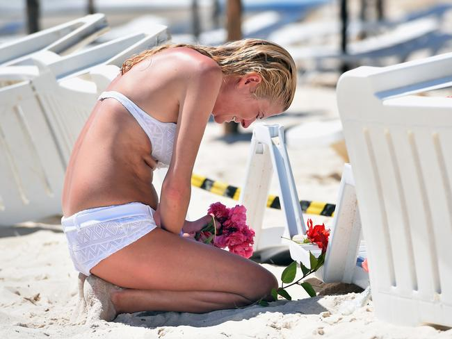 Mourning ... A woman grieves as she lay flowers at the beach next to the Imperial Marhaba Hotel where 38 people were killed in a terrorist attack in Tunisia on June 27, 2015. Picture: Jeff J Mitchell/Getty Images
