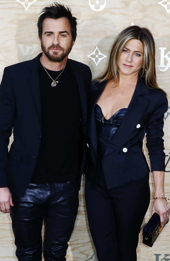 Theroux and Aniston co-ordinate with black leather in the city of love.