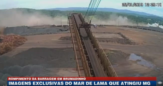 Residue from the dam inches its way towards the neighbouring town. Picture: Bandeirantes