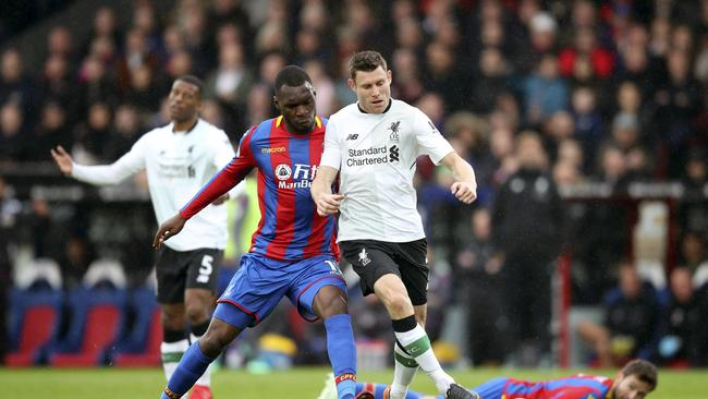 Crystal Palace's Christian Benteke, left vies for the ball with Liverpool's James Milner