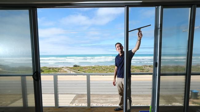 Andrew Walsh prepares his 172 Surfers Pde, Middleton home for the holiday rental market. PIC TAIT SCHMAAL.