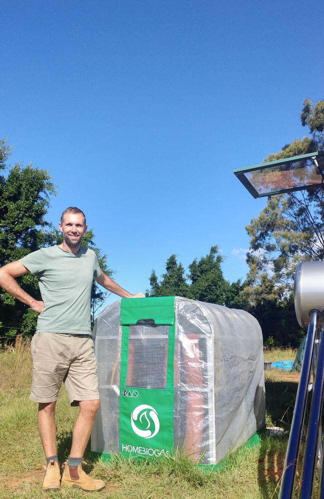 Paul posing with his biodigester. Picture: Media Drum World/Australscope