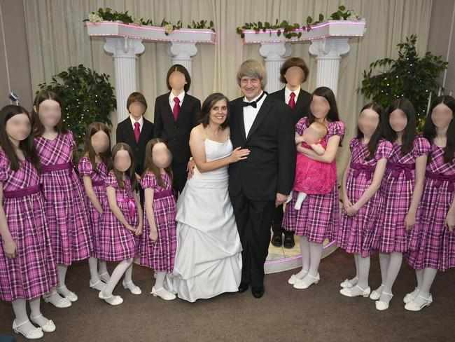 David Allen Turpin, 57, and Louise Anna Turpin, 49, with their 13 children at a ceremony to renew their wedding vows. Picture: Supplied