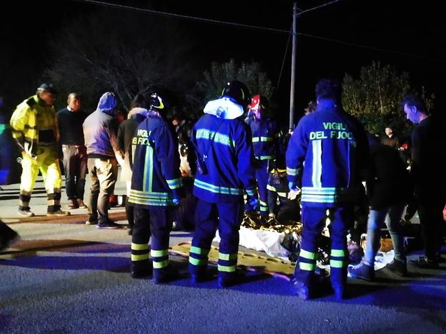 Emergency personnel treating victims after a stampede at a nightclub in Cornaldo. Picture: AFP