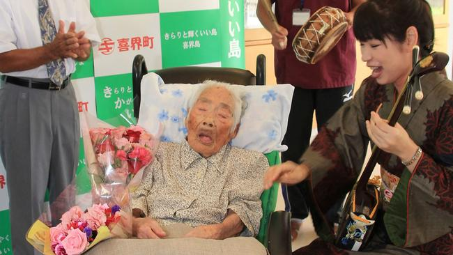Nabi Tajima, who is believed to have been the oldest person in the world aged 117, has died. She is shown here in her nursing home bed last year. Picture: AFP