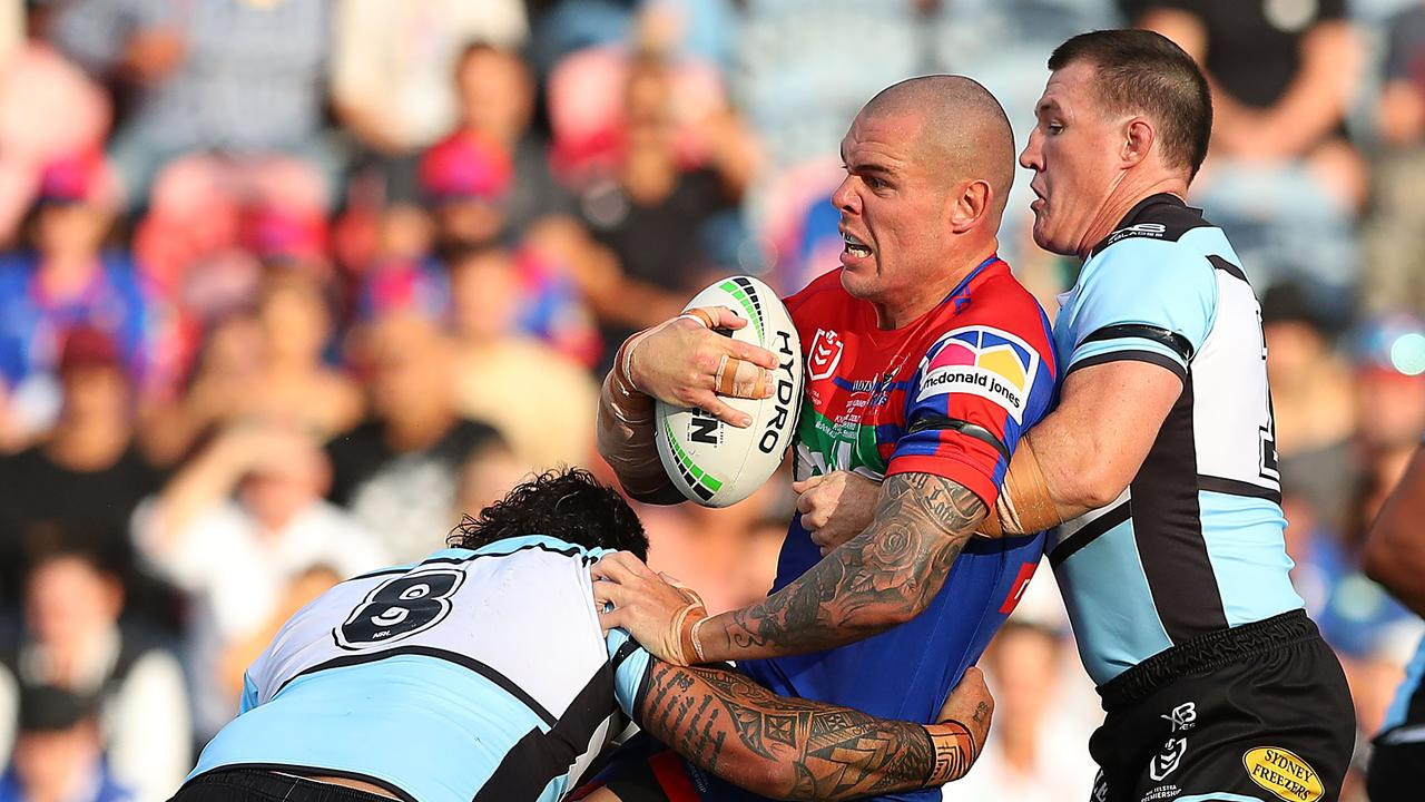 David Klemmer of the Newcastle Knights is tackled.
