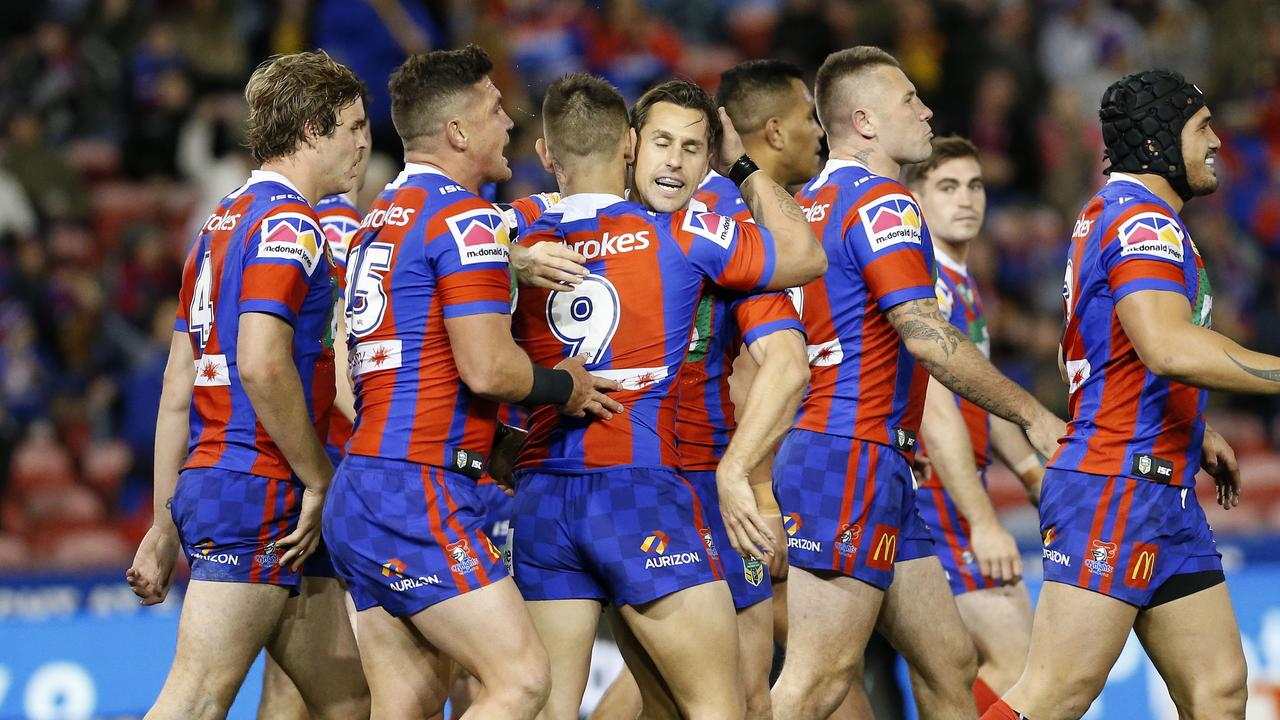 Mitchell Pearce celebrates a try with his teammates.