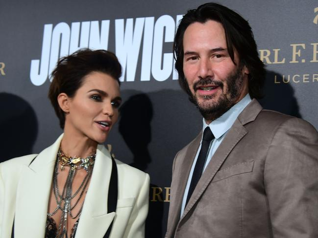Keanu Reeves and Ruby Rose promote John Wick Chapter Two. Reeves says he would like to revisit the role of Neo from The Matrix. Picture: AFP Photo/Frederic J. Brown