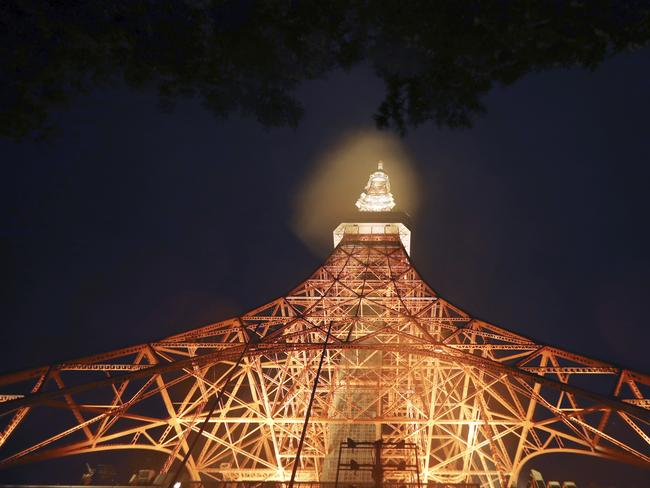 Tokyo Tower is lit in the pouring rain. Picture: AP