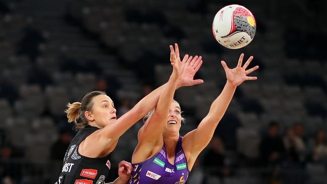 Magpies' Nat Medhurst battles with Firebirds star Gabi Simpson. Picture: Getty