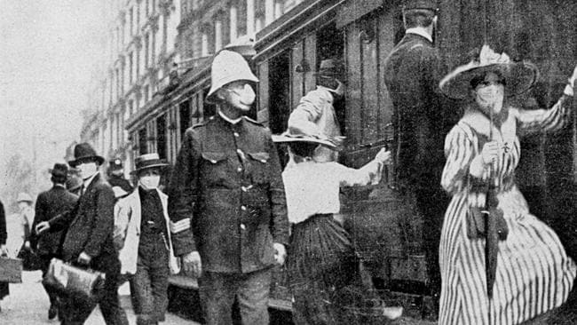 Train travellers in Sydney wear masks during the Spanish flu outbreak in 1919. Picture: File