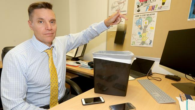 Pimpama State Secondary College principal John Thornberry getting rid of mobile phones after the school implemented a full mobile phone ban. Picture Mike Batterham