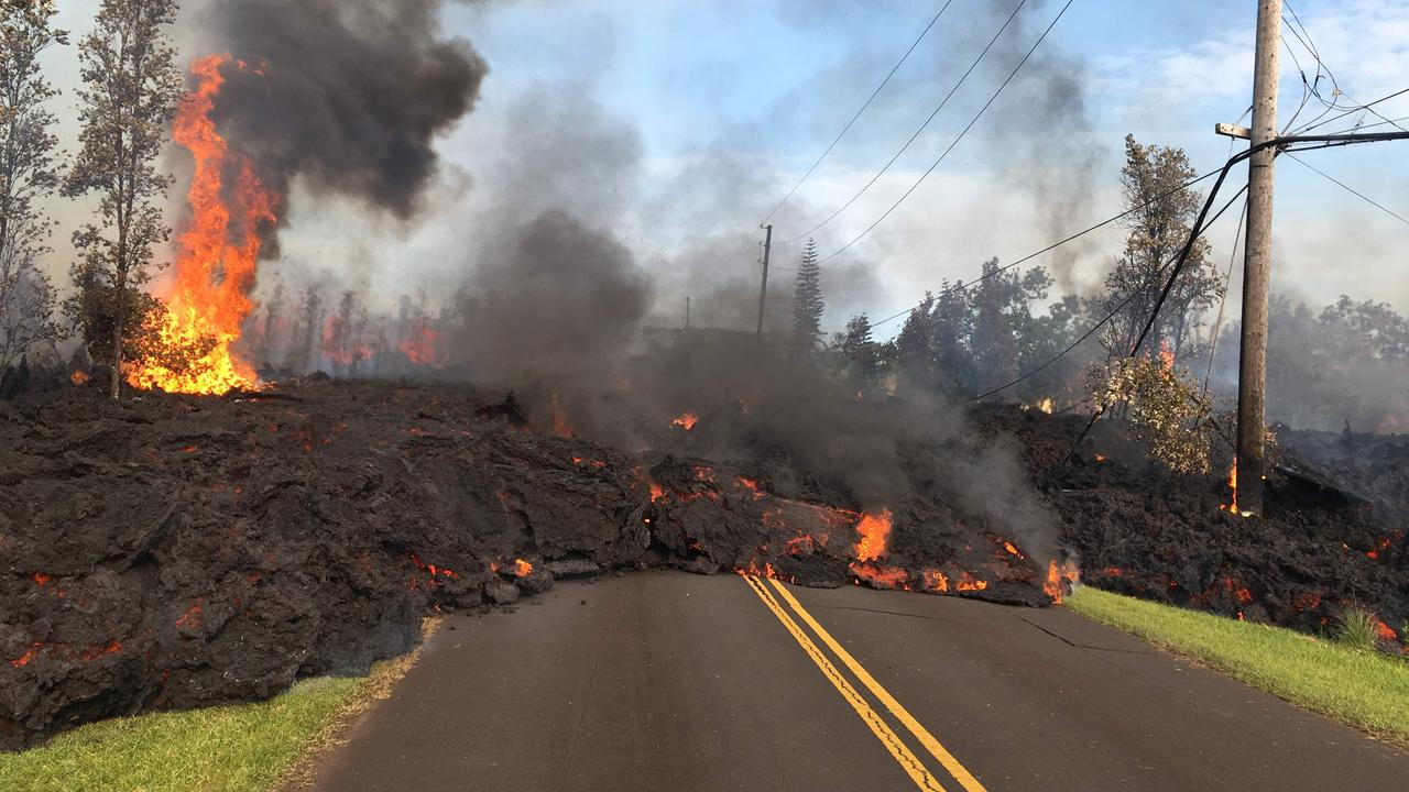 Lava slowly moving down a street in Leilani Estates, Hawaii. Picture: AFP